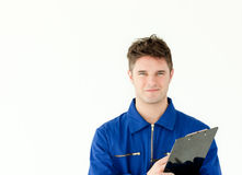 Good-looking male worker holding a document. Against white background Stock Photo