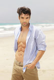 Good looking man. Good-looking man on beach with open shirt Stock Photography