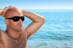 Good looking man on the beach. Summer stock image