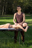 A good-looking man doing a back massage Stock Images