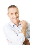 Good looking man with folded arms. Smiling mature man with folded arms Stock Photos