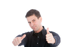 Good looking man giving a thumbs up gesture. Of approval and praise with both hands to signal his support, isolated on white Stock Images