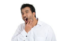 A good looking man having sensitivity in his tooth, looking away in pain Stock Image