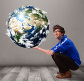 Good-looking man holding 3d planet earth Royalty Free Stock Images