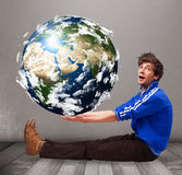 Good-looking man holding 3d planet earth Royalty Free Stock Photos