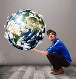 Good-looking man holding 3d planet earth royalty free stock photo