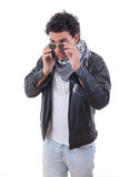 Good looking man in a leather jacket talking over phone Royalty Free Stock Photography
