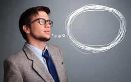 Good-looking man thinking about speech or thought bubble with co Stock Photos