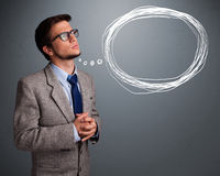 Good-looking man thinking about speech or thought bubble with co Stock Photography