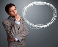 Good-looking man thinking about speech or thought bubble with co Royalty Free Stock Photo