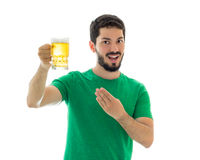 Good looking man toasting with bier. Royalty Free Stock Images
