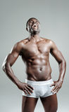 Good looking muscular man laughing Stock Photo