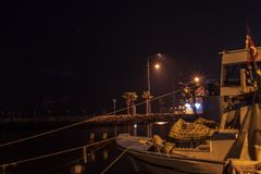 Good looking nightscene - there is a boat and city lights. Photo has taken at izmir/turkey stock photo