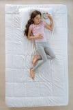 Good looking peaceful girl enjoying her sleep Stock Image