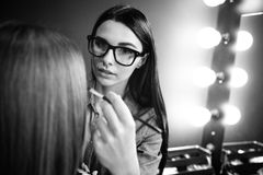 Good looking pleasant makeup artist being at work Royalty Free Stock Photography
