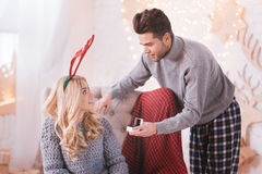 Good looking pleasant man proposing to his girlfriend Stock Images