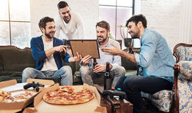 Good looking pleasant men discussing a picture Royalty Free Stock Image