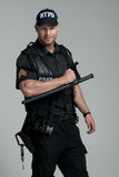 Good looking policeman bodybuilder posing Stock Photography