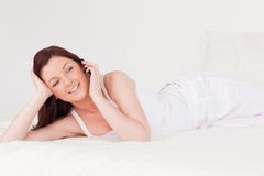 Good looking red-haired female relaxing Royalty Free Stock Image