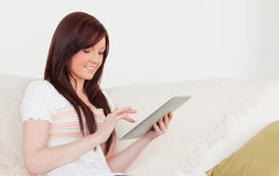 Good looking red-haired woman relaxing Stock Photography