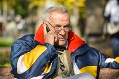 Good looking senior making phone call Stock Photos