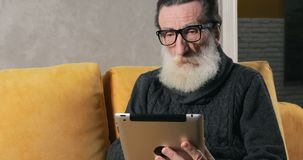 Senior man has problems with tablet stock video footage