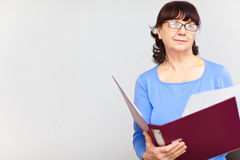 Good looking senior woman with folder Stock Photography