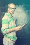 Good Looking Smart Nerd Man With Tablet Computer Royalty Free Stock Photography