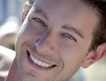Good looking smiling guy. Head shot of blue eyed attractive male model smiling Royalty Free Stock Images