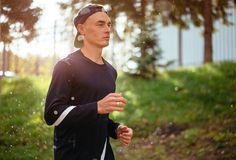 Good looking sportsman is taking part in the marathon stock photography