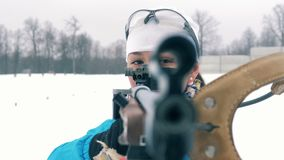 Good-looking sportswoman is drawing a bead from her rifle. 4K stock footage