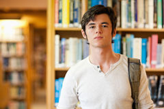 Good looking student standing up Stock Photo