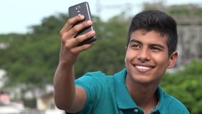 Good Looking Teen Boy Taking Selfy And Smiling stock footage