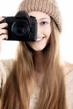 Good-looking teenage girl holding digital camera Royalty Free Stock Photos