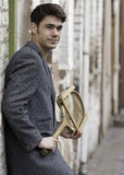 Gorgeous vintage man with a tennis racquet Stock Photography