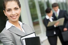 Good-looking woman. Image of good-looking businesswoman in grey suit outdoor Royalty Free Stock Photo