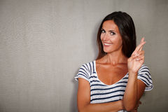 Good-looking woman crossing fingers while standing Stock Photo