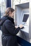 Woman at cash mashine Royalty Free Stock Image