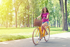 Free Good-looking Woman Looks Happy During Her Bicycle Ride In The Pa Royalty Free Stock Photos - 73959918