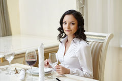 Good-looking woman posing during business lunch Royalty Free Stock Photography