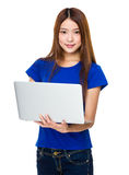 Good looking woman relaxing with her laptop Royalty Free Stock Images