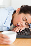 Good looking woman sleeping on a keyboard Stock Image