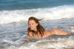 Good looking woman in the surf Stock Photography
