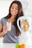 Good looking woman using a blender Stock Photos