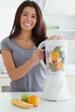 Good looking woman using a blender while standing Royalty Free Stock Photo