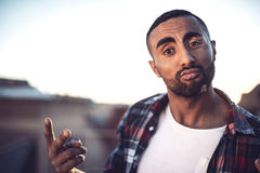 Good looking young arab man in casual clothes in urban environme Stock Image