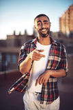 Good looking young arab man in casual clothes in urban environme Royalty Free Stock Photos