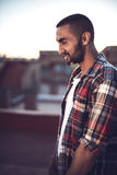 Good looking young arab man in casual clothes in urban environme Royalty Free Stock Image