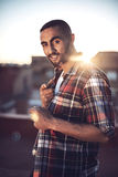 Good looking young arab man in casual clothes in urban environme Royalty Free Stock Photo