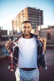 Good looking young arab man in casual clothes in urban environme Stock Images